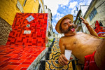 Photographic portrait of local street artist, Selaron, near his famous tile steps in the Santa Teresa district of Rio de Janiero, Brasil.