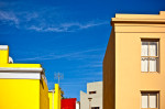 Photographic cityscape of the colorful Malay-inspired houses in Capetown, South Africa.