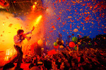 Photograph of Wayne Coyne of The Flaming Lips performing live at Free Press Summerfest 2011 in Houston, Texas.