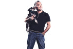 Photographic portrait of dog trainer, Cesar Milan, known as The Dog Whisperer.