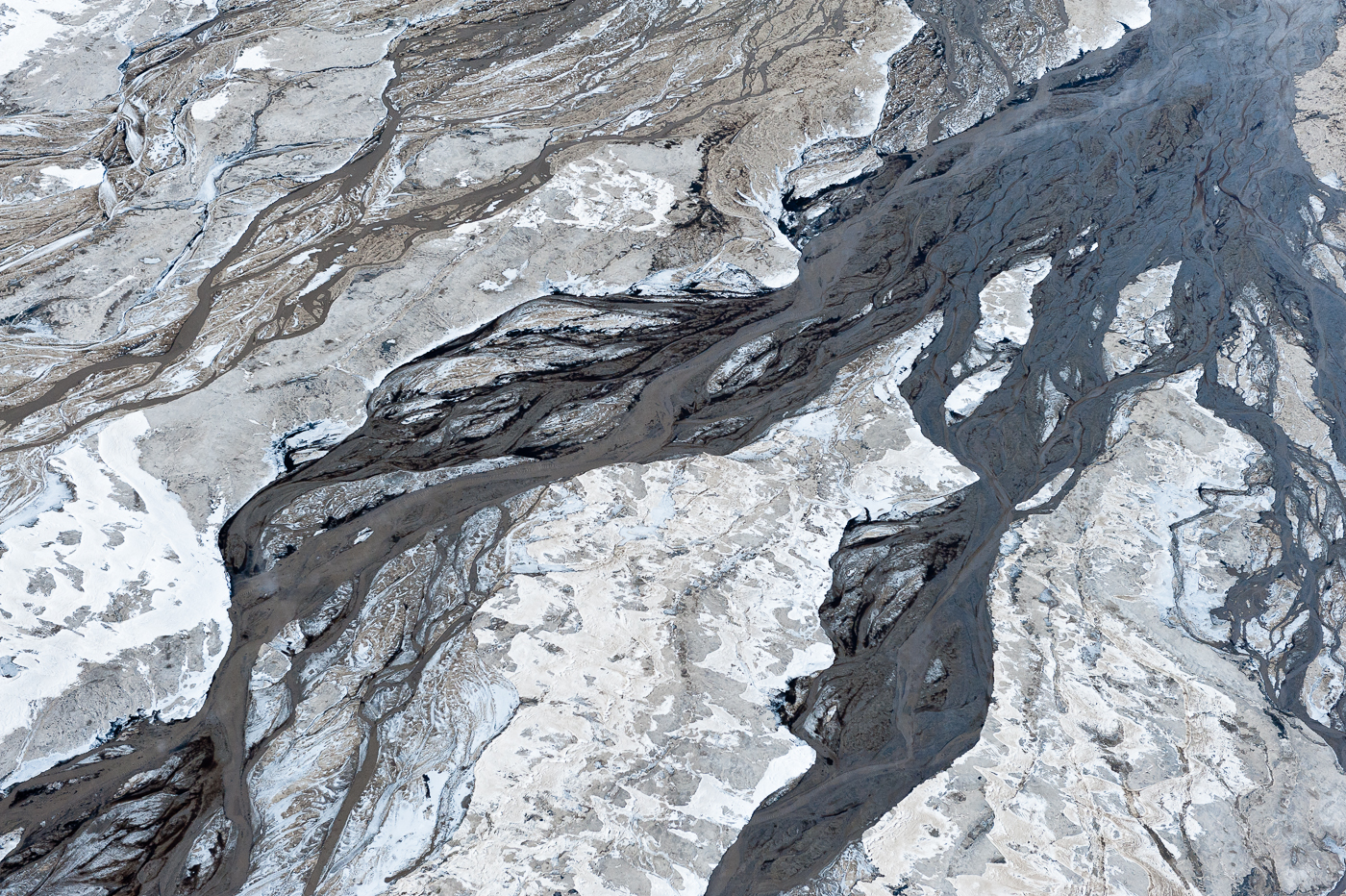 Even in the extreme cold of the winter, the toxic tailings ponds do not freeze. On one particularly cold morning, the partially frozen tailings, sand, liquid tailings and oil residue, combined to produce abstractions that reminded me of a Jackson Pollock canvas.