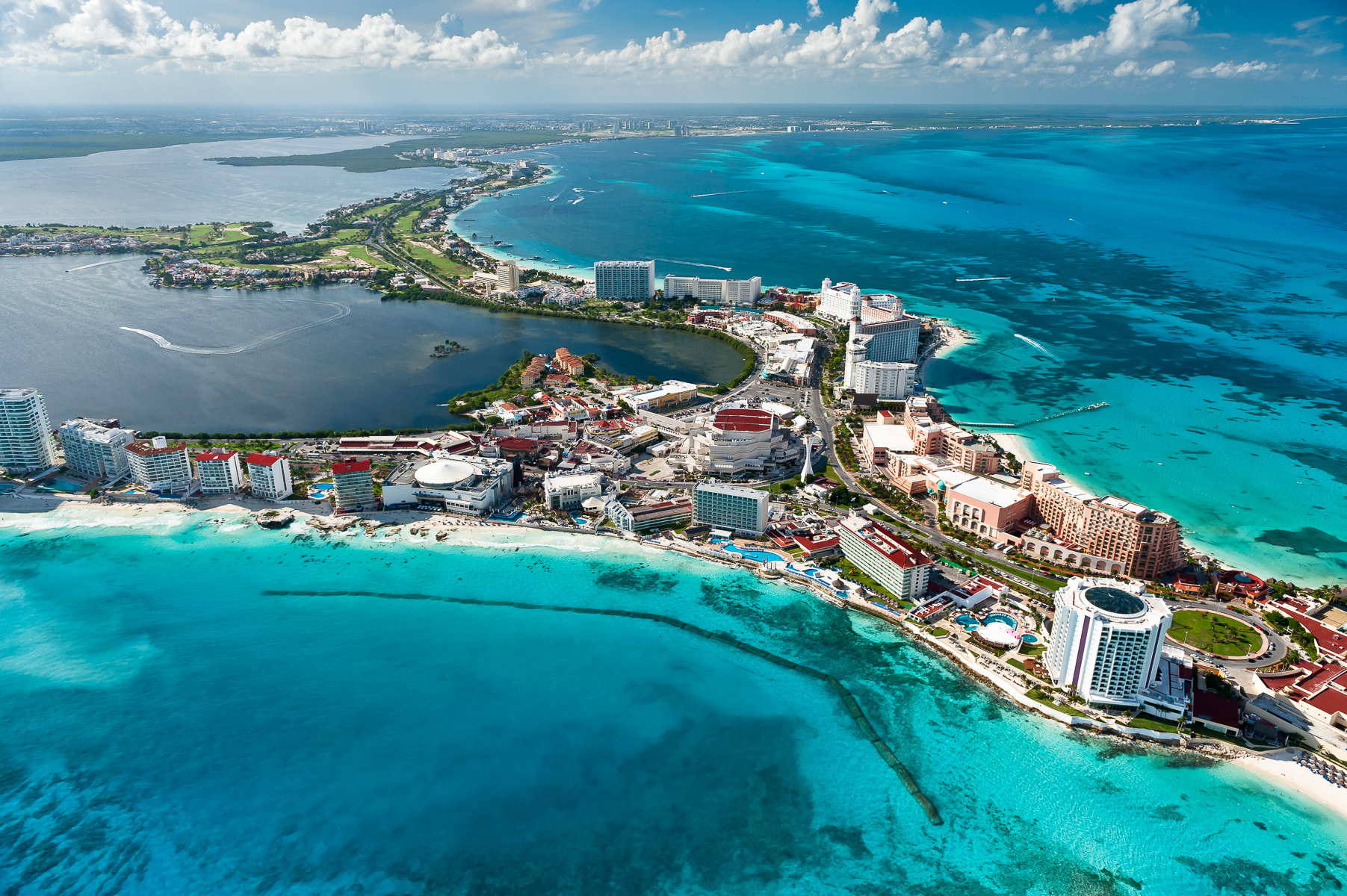 Yucatan iLCP {quote}RAVE.{quote} October 2010. Assignment: show impacts of tourism and development. Cancun showing density of development and proximity to coast. This contributes to erosion and loss of beach habitat.