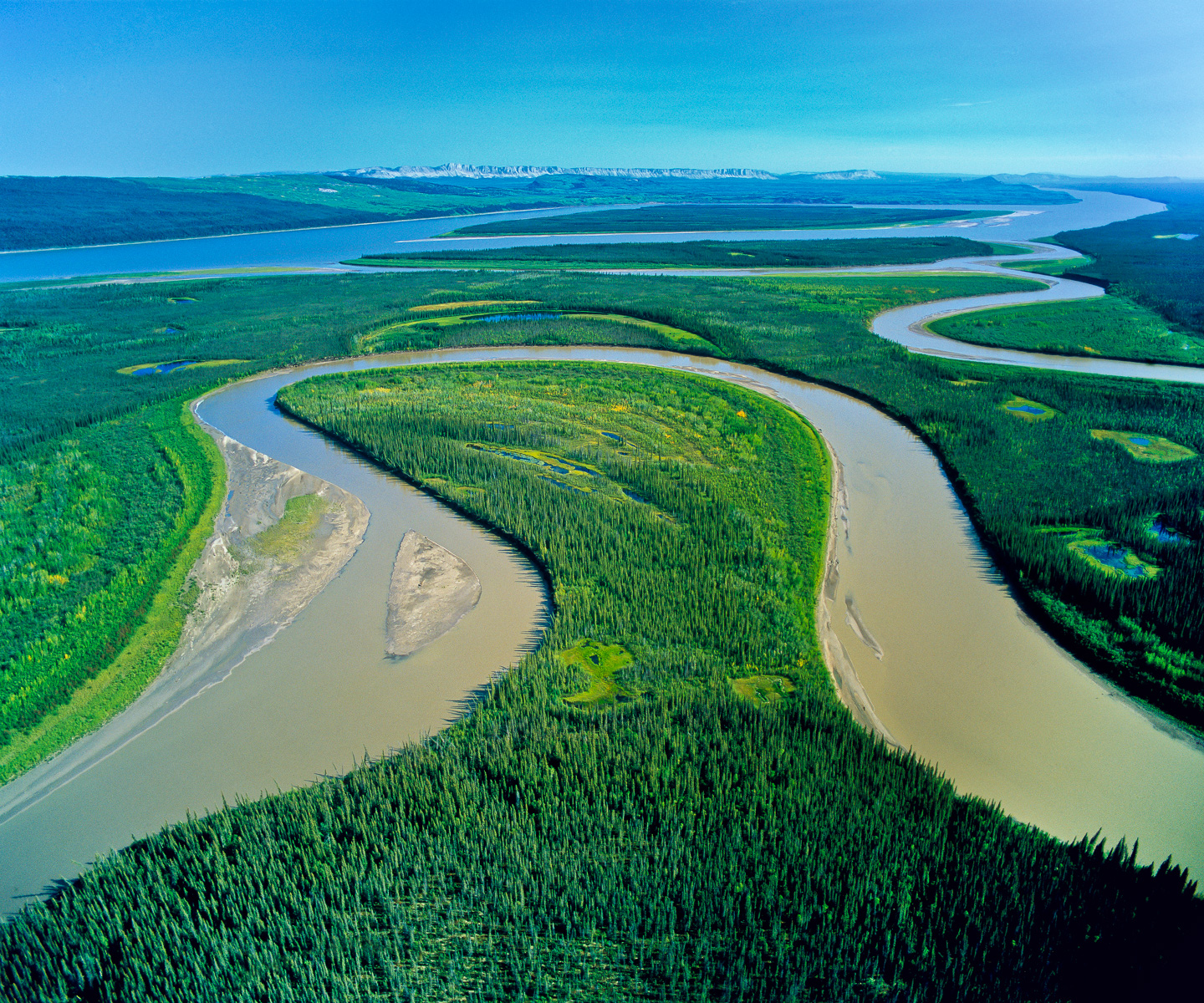 The Caracjou River winds back and forth creating this oxbow of wetlands as it joins the Mackenzie flowing north to the Beaufort Sea. This region, almost entirely pristine, is the third largest watershed basin in the world.