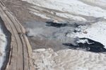 "The tailings ponds of the Alberta Tar Sands are the largest toxic impoundments in the world. Individual ""ponds"" can range in size up to 8850 acres. It has been estimated by Natural Resources Canada that the industry to date has produced enough toxic waste to fill a canal 32 feet deep by 65 feet wide from Fort McMurray to Edmonton, and on to Ottawa. Syncrude alone, dumps 500,000 tons of toxic tailings into just one of their tailings ponds everyday."