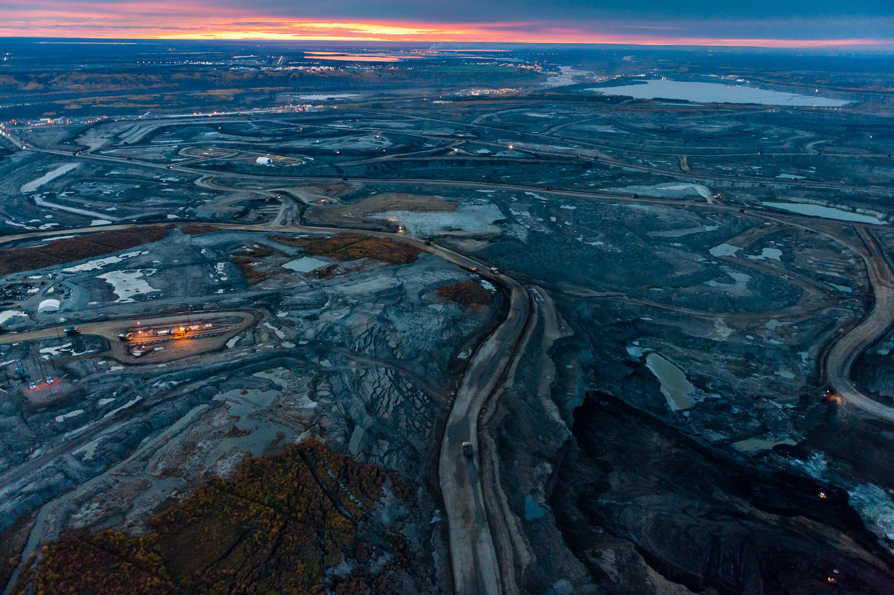 """Twenty four hours a day the Tar Sands eats into the most carbon rich forest ecosystem on the planet. Storing almost twice as much carbon per hectare as tropical rainforests, the boreal forest is the planet's greatest terrestrial carbon storehouse. To the industry, these diverse and ecologically significant forests and wetlands are referred to as overburden, the forest to be stripped and the wetlands dredged and replaced by mines and tailings ponds so vast they can be seen from outer space.Limited Edition Fine Art PrintsAll prices in U.S. dollars.Prices are for prints only and do not include tax or shipping.16""""x24""""  edition of 25  /  $100020""""x30""""edition of 15  /  $150030""""x45""""edition of 10  /  $350040""""x60"""" /        edition of 6   /   $6000"""