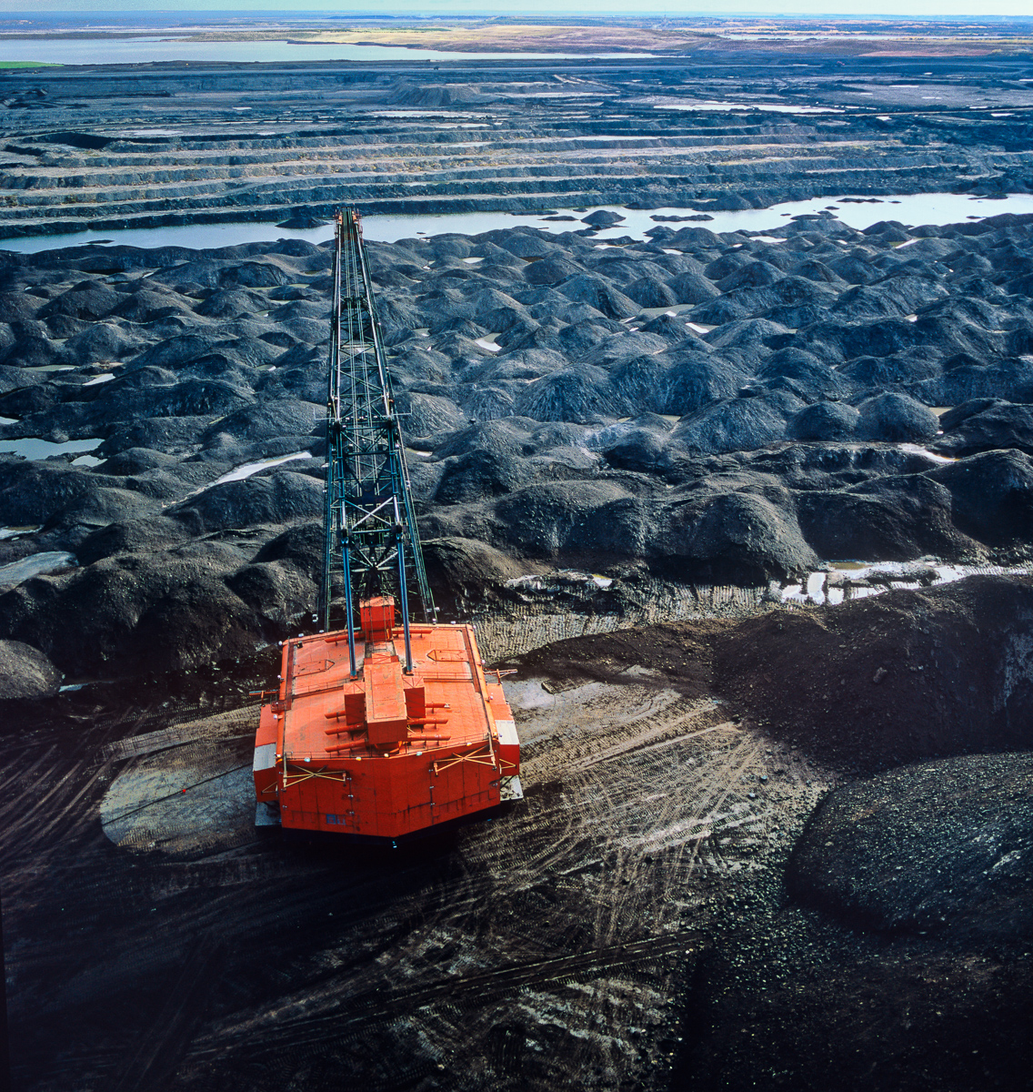 At the edge of an 80-meter deep mine, a massive tar sands machine. The mines, machinery, and trucks of the Alberta Tar Sands were the inspiration for Avatar's Edmonton-born art director's vision of the mining operation on Pandora.