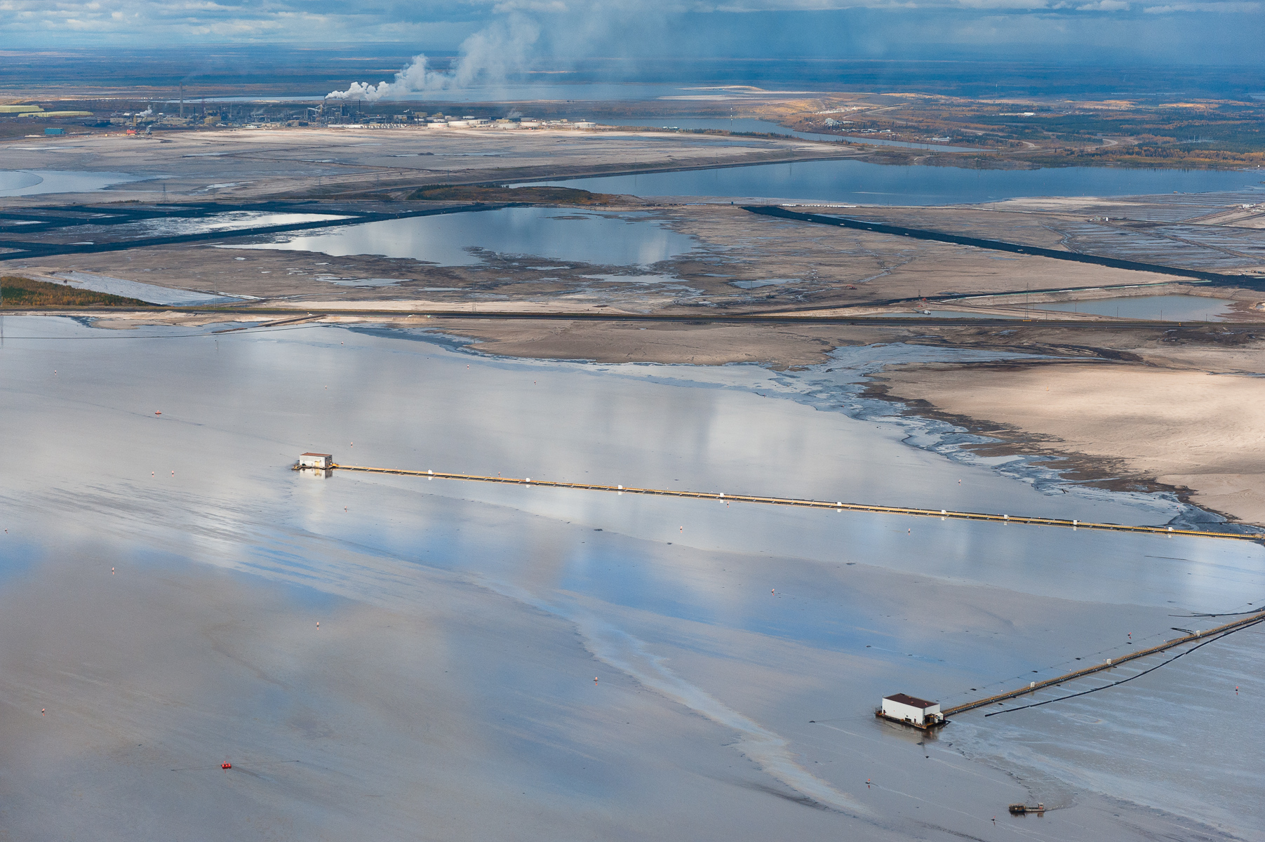Tailings Ponds. These vast toxic lakes are completely unlined and nearly a dozen of them lie on either side of the Athabasca River. Individual ponds can range in size up to 8,850 acres.