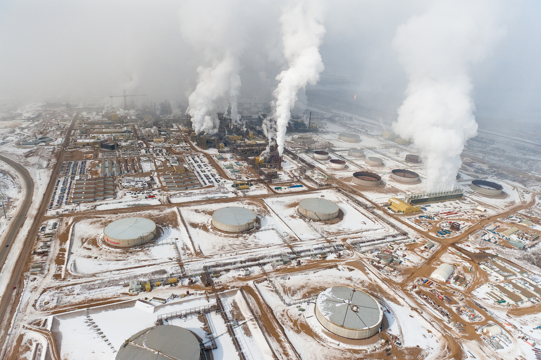 """Tar Sands Upgrader in Winter                                                                    Northern Alberta. Canada. 2010. The Alberta Tar Sands are Canada's single largest, and fastest growing, source of carbon. They produce about as much carbon annually as the nation of Denmark. The refining of the tar-like bitumen requires far more water and energy than the production of conventional oil and produces significantly more greenhouse gas.    Limited Edition Fine Art PrintsAll prices in U.S. dollars.Prices are for prints only and do not include tax or shipping.16""""x24""""  edition of 25  /  $100020""""x30""""edition of 15  /  $150030""""x45""""edition of 10  /  $350040""""x60"""" /        edition of 6   /   $6000"""