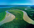The Caracajou River winds back and forth creating this oxbow of wetlands as it winds it way to join the Mackenzie flowing north to the Beaufort Sea.    This region, almost entirely pristine, and the third largest watershed basin in the World, is the setting for the proposed Mackenzie Valley National Gas Pipeline to fuel the energy needs of the Alberta Oil Sands mega-project.Exhibition print:  35{quote}x45{quote} archival pigment print on Hahnemuhle bamboo, bonded to aluminum.