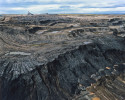 Tar Sands pit mining is done in benches or steps. These benches are each approximately 12-15 metres high. Giant shovels dig the tar sand and place it into heavy hauler trucks that range in size from 240 tons to the largest trucks, which have a 400-ton capacity.24