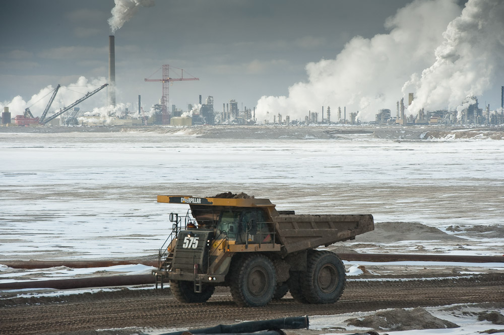 Truck, tailings pond, and syncrude upgrader.
