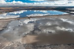 "So large are the Alberta Tar Sands tailings ponds that they can be seen from out space. It has been estimated by Natural Resources Canada that the industry to date has produced enough toxic waste to fill a canal 32 feet deep by 65 feet wide from Fort McMurray to Edmonton, and on to Ottawa, a distance of over 2000 miles. 20""x30""          Edition of 10          $150030""x45""          Edition of 10          $3200*40""x60""         Edition of 5            $6000*Exhibition print:40""x60"" archival pigment print on Hahnemuhle bamboo, bonded to aluminum."