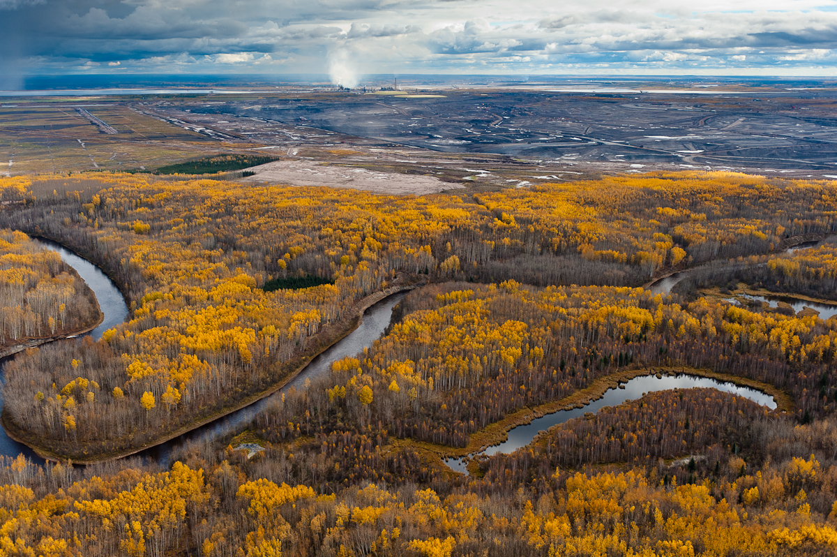 The boreal forests and wetlands that surround the Tar Sands are the most carbon rich terrestrial ecosystem on the planet, holding almost twice as much carbon as tropical rainforests. Referred to by the tar sands industry as {quote}overburden,{quote} these forests are scraped off and the wetlands dredged, to be replaced by tar mines like this. Exhibition print:  30{quote}x45{quote} archival pigment print on Hahnemuhle bamboo, bonded to aluminum.