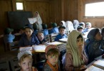 Kalash and Muslim students share a classroom  built by the Aga Khan Foundation with European Community funds in the Bumburet Valley, where Muslims and Kalash coexist. Funds are administered when a community agrees to build and administer a school, especially one that provides female education in areas where illiteracy among women can top 50%.