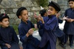 Kalash children outside the Kalasadur School in the village of Brun. Built by the Greek Teachers NGO, the school for Kalash children reinforces the indigenous culture of the Kalash people of Pakistan's Hindu Kush Mountains.