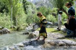Kalash children play in the glacial river that runs through the Bumburet Valley and their village of Brun, providing the community with fresh, clean water for agriculture, drinking and bathing.
