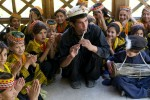 A Kalash teacher instructing children in traditional music at the Kalasadur School in the village of Brun. Built by the Greek Teachers NGO, the school aims to reinforce the indigenous culture of the Kalash people of Pakistan's Hindu Kush Mountains.