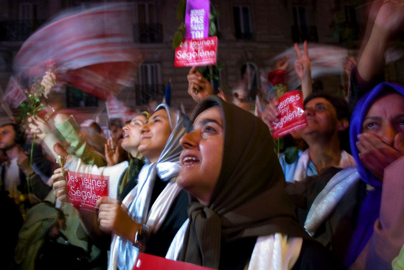 PARIS, 2007: Iranian supporters of French presidential candidate Ségolène Royal listen cheer as she faces off against NicolasSarkoz.