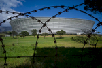 Barbed wire rings the golf course and Soccer Stadium that was built for the 2010 World Cup Soccer event in Cape Town, South Africa. Photos taken by Anacleto Rapping ©2012