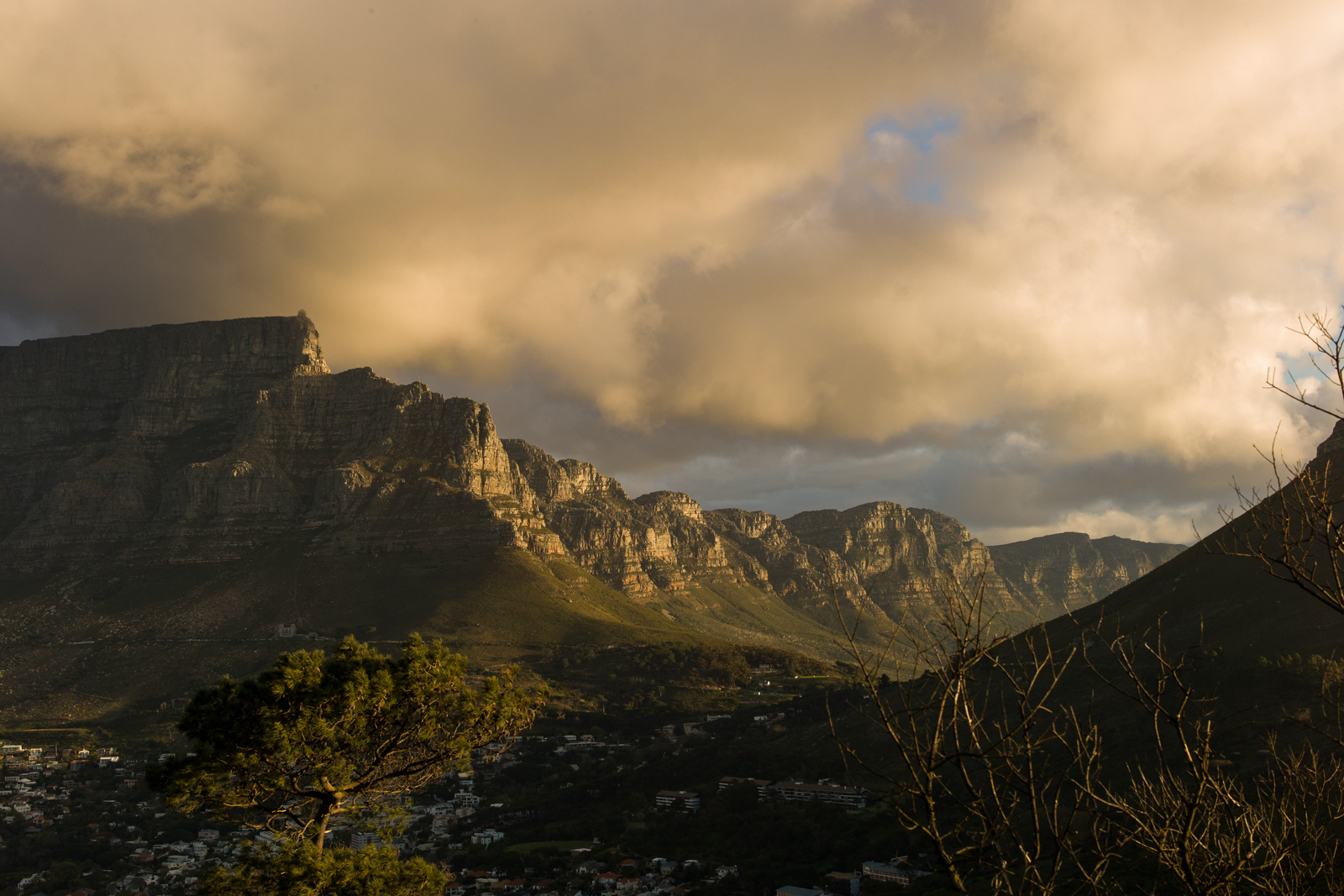 Sunset view from the top of Signal Mountain, Cape Town looking at Table Mountain (left) and the 12 Apostles.   Photographs by Anacleto Rapping ©2012