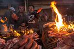 The Khayelitsha township which means \{quote}new home\{quote}, in the Cape Flats of South Africa. The Braai market area is where local vendors Khanyisa Mgidi (left) and Yolanda Mpongwana (right)  grill pork, beef and sausages for customers. some customers will stop  to eat but mostly to take away the meats. Photos taken 10/1/12 by Anacleto Rapping ©2012