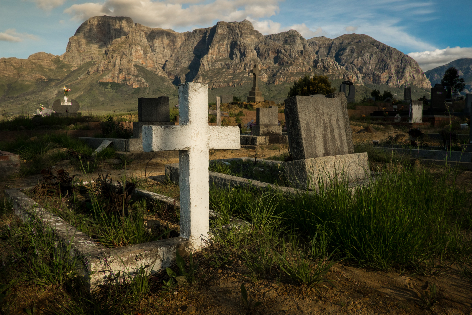 The small cementery in the town of Pniel leads to wine country Stellenbosch and Franschhoek in the Western Cape.  This part of South Africa is well known for it\'s vineyards and fine wines.. . Photos taken in South Africa by Anacleto Rapping ©2012