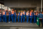 Downtown Cape Town construction workers line up for their evenig shift on Long Street.  Photos taken in South Africa by Anacleto Rapping ©2012