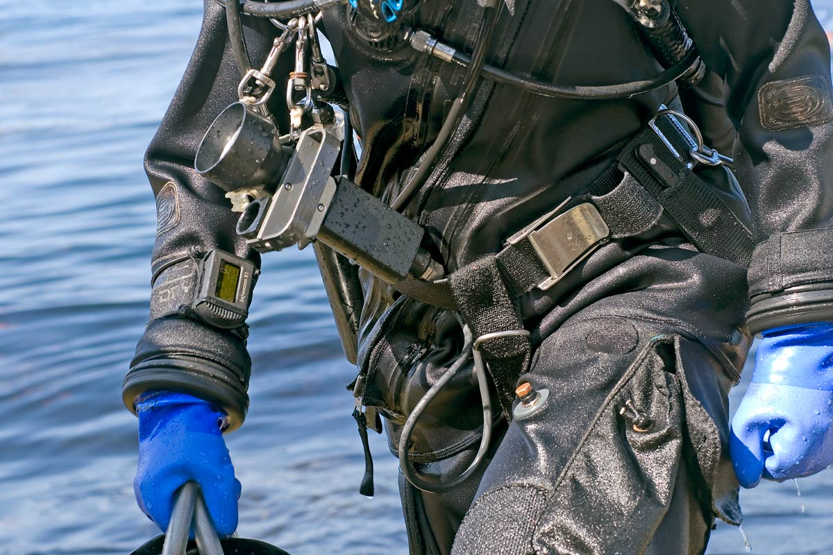 The demo for this dive computer is highly trained, rugged, generally cold water divers.  This shot supports the branding of this product into the demographic.