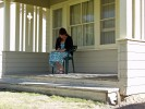 Jaye writing to a friend. Hot summer day, cool in the shade.