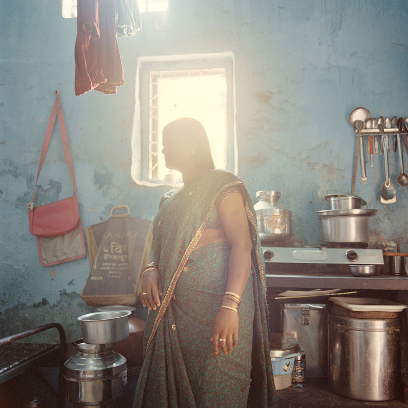 M., 27, inside her new agent's home, is about to have her hormones injection done, to prepare for the embryo implantation. Ulhasnagar, January 2013.