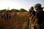 San Marcos, San Vicente district, San Pedro--October 27, 2008--National police stand guard at the edge of a Brazilian-owned genetically modified soybean farm, after a court-ordered eviction of a landless farmers' settlement on the edge of the property. Peasant farmers' demands for land have increased since a soy-farming boom gathered pace five years ago in Paraguay. A wave of land takeovers is sweeping the nation, putting the $600 million dollar transnational soy industry in Paraguay at risk, which represents more than 30 percent of total exports for the country. Soy production has increased exponentially in recent years due to rising demand worldwide for meat and cattle feed, and the booming biodiesel industry. Industrial soy is directed toward these markets. Most of the soybean producers are Brazilian and Argentinian who moved to Paraguay in the last 10-15 years. Of the current 600,000 soybean producers in Paraguay, only 24% are Paraguayan.