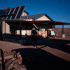 Carlos Proffit outside of his home in Pajarito Mesa, New Mexico, USA on Feb. 15, 2011. Mr. Proffit moved to the Mesa {quote}to escape the rent cycle,{quote} and then built his own home. He slowly learned to install and in some cases build solar and wind solutions for his home over the course of many years.