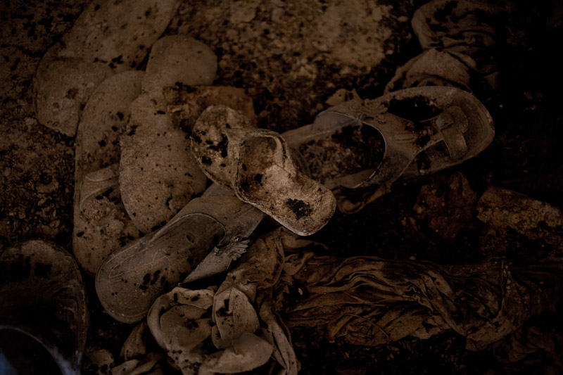 A pile of sandals, including those of a child, inside an office building in Blolekin, where dozens if not hundreds of people were killed during post-election violence. As fighting intensified, the Forces Republique de Cote d'Ivoire had gathered all of their civilians from the surrounding area into a building they deemed safe; but the retreating militias loyal to former President Gbagbo broke in and killed everyone they could.