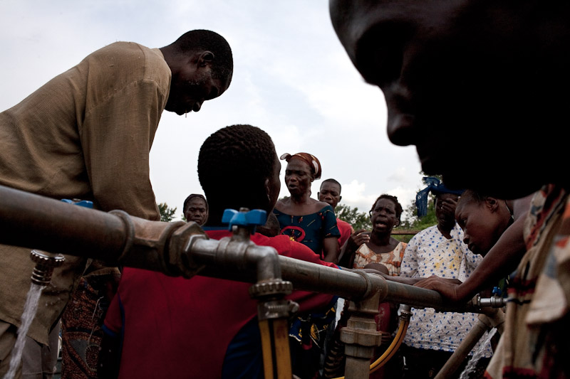 People argue over water distribution in a camp for internally displaced people at the Catholic Mission in Duékoué.