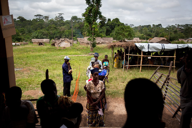 Villagers wait for a consultation at an MSF mobile clinic held at a health center in Glepleu, western Ivory Coast. During post-election violence, the villagers fled over the nearby border into Liberia, and the health center was looted. Now most people have returned, but there is no infrastructure to provide for basic health needs. MSF comes twice a week to support the one local nurse at the center.