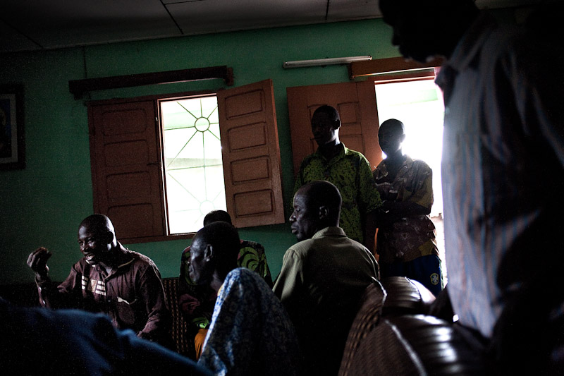 The leaders of several immigrant tribes meet to discuss post-war issues in a home in Guiglo. Western Ivory Coast is home to a large population of immigrants, mostly cocoa farmers, predominantly from Burkina Faso, Mali, and other regions of Ivory Coast. The leaders agreed that they would urge their people to end reprisal killings against the native tribes.