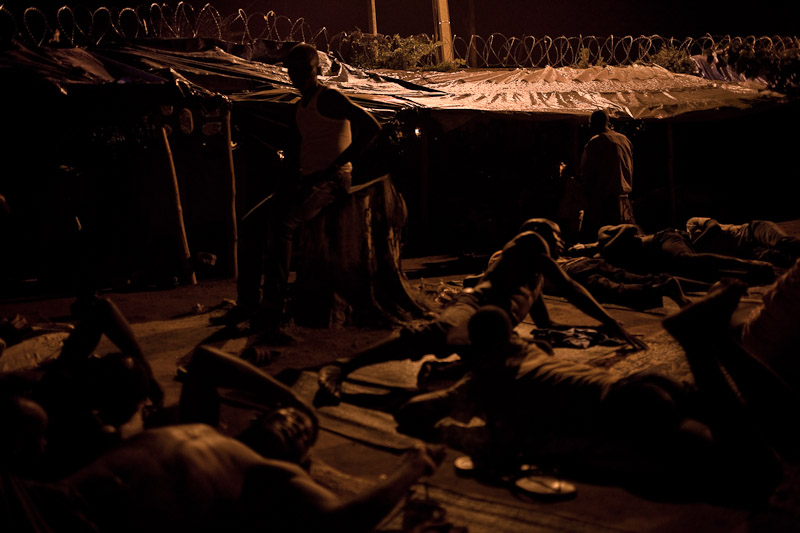 Men lie down to sleep in a camp for internally displaced people at the Catholic Mission in Duékoué. Most of the displaced live just down the road, but they are too afraid leave the safety of the camp.