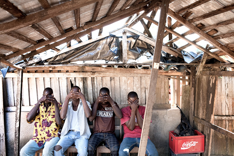 Four young men hide their faces after recounting their story of post-election violence, Guiglo, western Ivory Coast. The four of them survived a massacre committed by retreating pro-Gbagbo forces in nearby Blolekin.