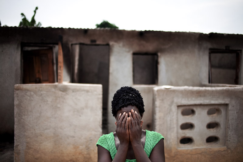 A woman hides her face after recounting her story of post-election violence in Duékoué, western Ivory Coast. Advancing pro-Ouattara forces killed two of her children and one of her brothers. She now lives in a nearby camp for internally displaced people, as she is still too scared to permanently return home. Estimates of the total number killed in Duékoué are as high as 800 people.