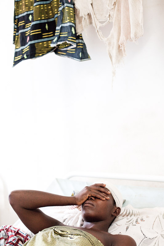 A woman hides her face after recounting the story of her injuries and assault during post-election violence, Bangolo Hospital, western Ivory Coast. She was hiding in the bush for four days after fleeing from her neighborhood, but was eventually found and was beaten and sexually assaulted. Her two-year-old son was shot and killed as they fled.