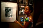 Ghanaian Parliamentary candidate Samia Nkrumah points out a photograph of her father, Ghana's first president Kwame Nkrumah, at the museum in Kwame Nkrumah Memorial Park in Accra, Ghana.