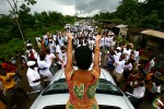 Samia Nkrumah waves to supporters upon arriving at Eluba, Ghana. Nkrumah is campaigning for a parliamentary seat in the area where her father was born, and manypeople there still consider him a national hero.