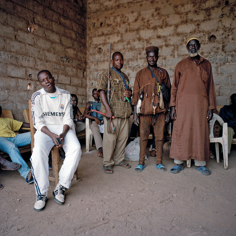 A group of Dozo, or traditional hunters, pose for a photograph at their encampment in Duekoué, Ivory Coast. The role of the Dozo in last year's post-election violence is unclear; while many maintain that they are the protectors of the region, supporters of former president Laurent Gbagbo insist that the Dozo joined with the advancing opposition army and participated in heavy fighting and even massacres.