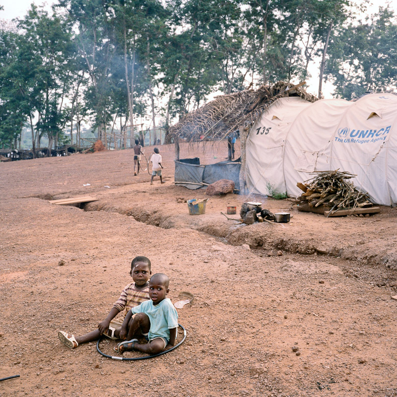 Young children play with tent poles at the Nahibly refugee camp outside of Duekoue, Ivory Coast.