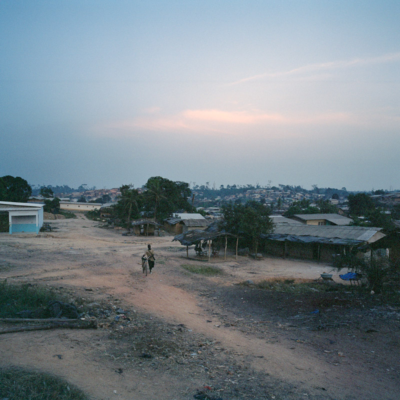 An overview of Moussadougou, Ivory Coast. Moussadougou is a farming community that has rapidly grown to 30,000 people over the past few decades, most of them {quote}immigrants{quote} from northern Ivory Coast.