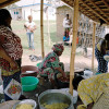Women from varied ethnic groups work together to prepare a meal for a reconciliation ceremony in the Carrefour neighborhood of Duekoue, Ivory Coast.