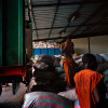 Manual laborers unload trucks of cocoa at Saf Cacao in San Pedro, Ivory Coast.