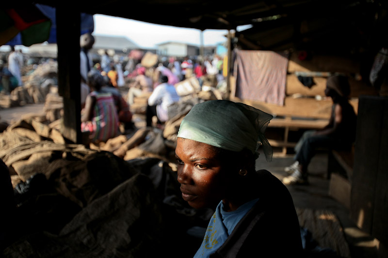 Lamisi sits waiting for work in an Accra market.