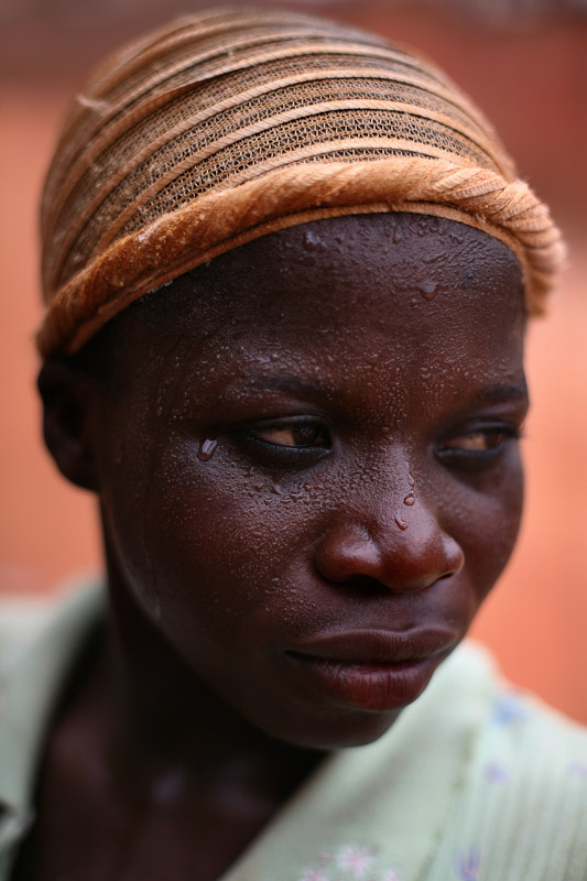 A Kayayo girl sweats after running after a car, hoping that the passengers would pay her to carry their bags in Kumasi, Ghana. Kayayo means {quote}porter{quote}, and is the term used for the thousands of girls and women who migrate from barren, northern Ghana to find work in southern cities.