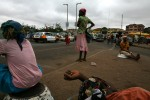 Teenage Kayayo girls wait for work at an intersection in Kumasi.